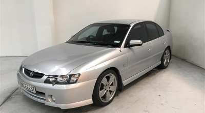 Report - KWL675 - 2004 HOLDEN COMMODORE in SILVER